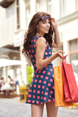 go to the shopping: Young beautiful woman with shopping bags in the ctiy- Lets go shopping concept