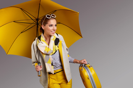 umbrella: Glamour woman with yellow umbrella and suitcase