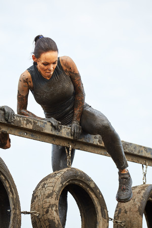 outdoor exercise: Extreme survival race concept. Action woman