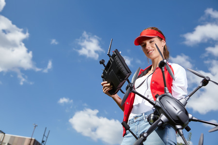 filmmaker: A woman is standing and holding drone Stock Photo