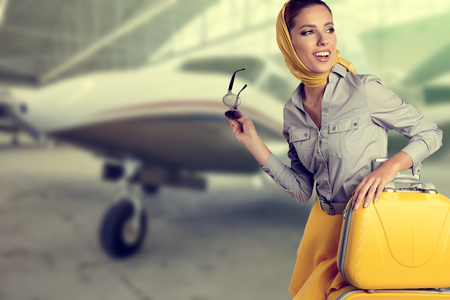 vintage woman: Vintage young female passenger at the airport (shallow DOF; color toned image)