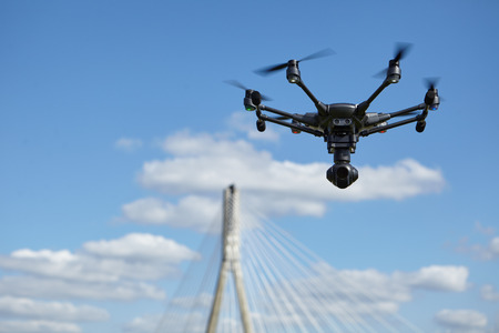 rc: Copter flight against the blue sky. RC aerial drone. Stock Photo