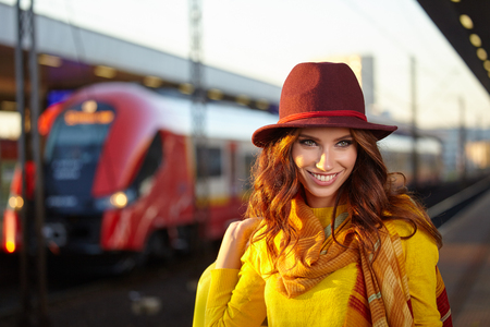 Caucasian woman: Autumn girl on the go, the situation at the railway station