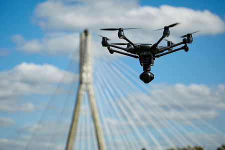 flying drone with camera on the sky Stock Photo
