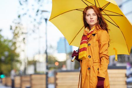 woman umbrella: Woman in autumn city Stock Photo