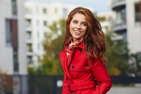 Woman in autumn city Stock Photo