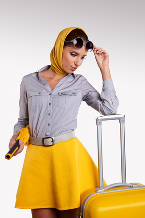 vintage travel: Vintage woman with yellow suitcase. travel concept