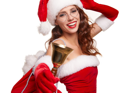 hispanic girl: christmas, x-mas, winter and people concept - smiling woman in santa helper hat with jingle bells