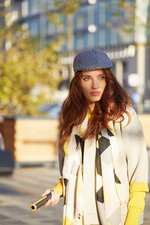 Young beautiful woman in sun autumn street. outdoor city Stock Photo