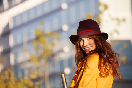 Young beautiful woman in sun autumn street. outdoor city Stock Photo