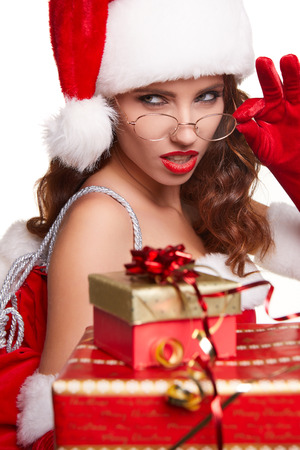 white hat: beautiful sexy girl wearing santa claus clothes with christmas gift
