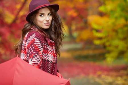 Young woman in autumn park.