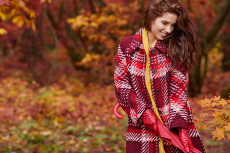 leather gloves: Autumn woman in autumn park with red umbrella, scarf and leather gloves