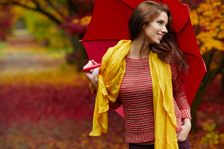 red gloves: Autumn woman in autumn park with red umbrella, scarf and leather gloves