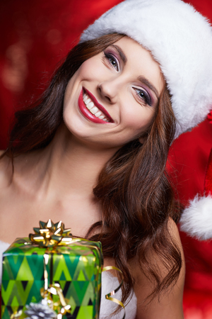 female christmas: Christmas vintage brunette with gift box, isolated on grey. Fashion in retro style Stock Photo