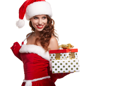 pretty brunette woman: sexy new year woman or girl with long brunette hair and pretty face in red christmas santa claus holiday dress Stock Photo