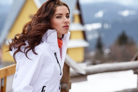 sexy snowboarder woman outdoors. Winter resort Stock Photo