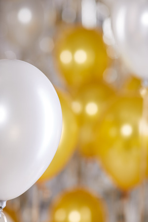 gold silver: Golden balloons background. New Year concept