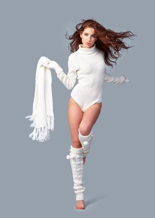 winter fashion: Beautiful winter fashion model. Studio shoot Stock Photo