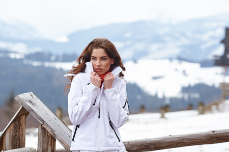 sport clothes: winter, leisure, sport and people concept - happy young woman in ski clothes outdoors Stock Photo