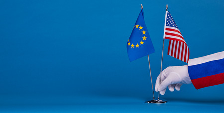 Two flags on a blue background, the political concept
