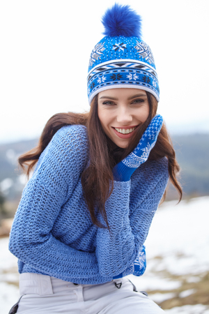 Portrait of happy young woman have fun at beautiful sunny winter day Stock Photo