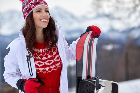 woman winter outdoor snowboarding concept.