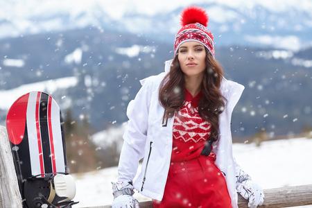 winter woman: woman winter outdoor snowboarding concept.