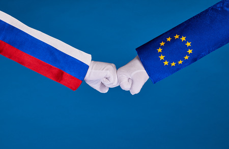 Picture of partnership handshake with two people hands, shaking hands in a national flag