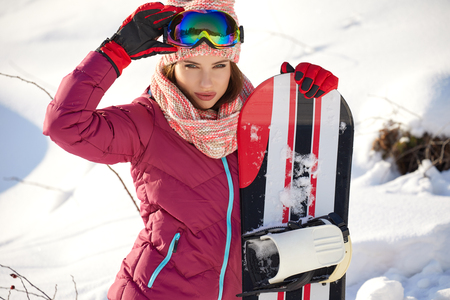 beautiful woman with a snowboard .