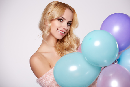 Young beautiful blonde girl holding balloons Stock Photo