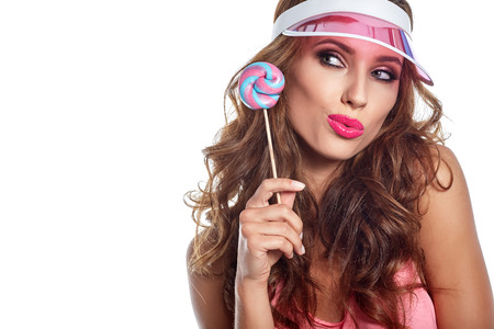 sexy lollipop: Beautiful amazing sexy smiling woman with a lollipop on white  background. Brunette girl studio portrait licking candy.