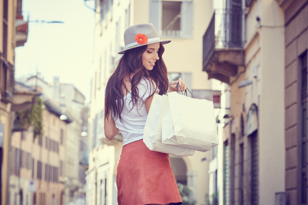 Young beautiful woman with shopping bags in the ctiy- Italian lifestyle Stock Photo