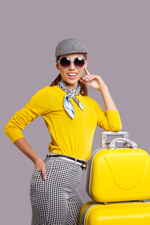 Glamour woman with yellow suitcase, travel concept