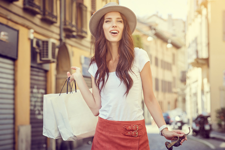 lifestyle shopping: Fashionably dressed woman on the streets of a small Italian town Stock Photo