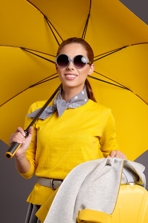 Beautiful sexy girl with a yellow suitcase loves to travel Stock Photo