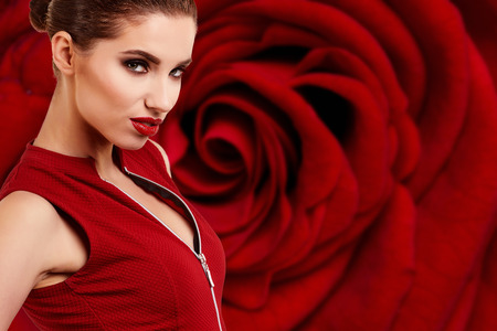 women s legs: pretty woman on  red rose background,  sensual portrait
