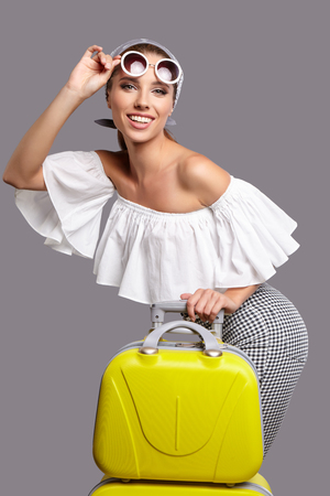 vacation summer: Glamour woman with yellow suitcase, travel concept