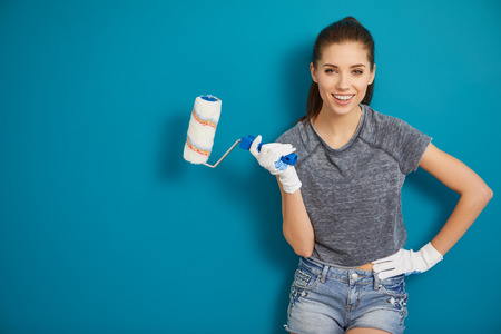 bright picture of lovely housewife painting at home Stock Photo