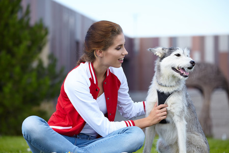 endear: Woman playing with her dog outdoors