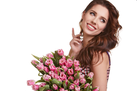 Beauty delicate woman smelling spring flowers Stock Photo
