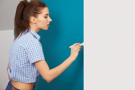 brush painting: Brunette girl having a break while renovating home