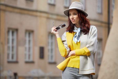 looking away from camera: Beautiful brunette woman in chic fashion Stock Photo