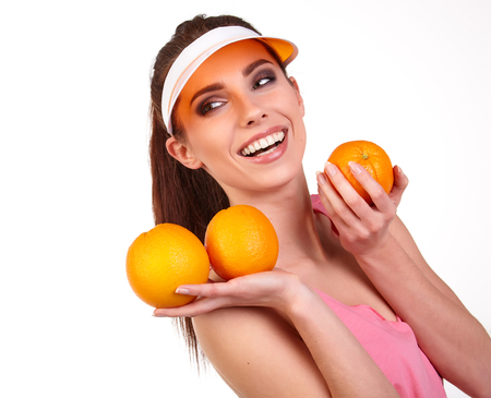 Beautiful close-up young woman with oranges. Healthy food concept Stock Photo
