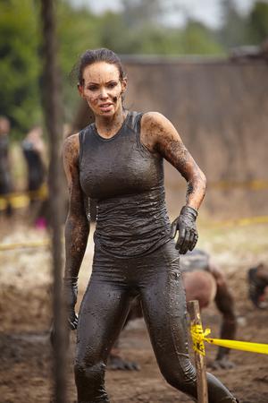 crosscountry: extrim race concept. Survival woman