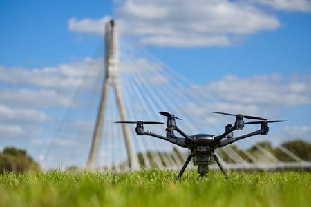 Drone for industrial works flying in sky.