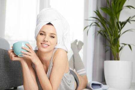 hotel bedroom: Young woman after shover having a morning milk Stock Photo