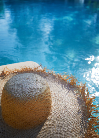 sunhat: hat by a swimming pool. Backgroud concept