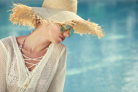 swimm: Portrait of beautiful tanned sporty slim woman relaxing in swimm