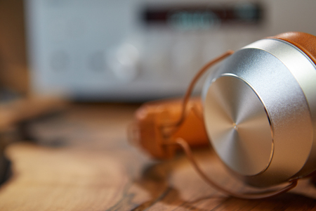 Vintage Headphones lie on a wooden table.